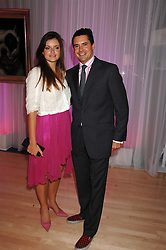 LADY NATASHA RUFUS-ISAACS and EDWARD TAYLOR at the Lauren-Perrier 'Pop Art' Pink Party in aid of Capital 95.8's Help A London Child, held at Suka at the Sanderson Hotel, 50 Berners Street, London W1 on 25th April 2007.<br />