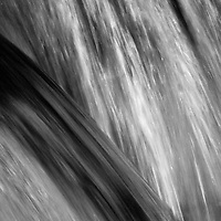 Black and white abstract of a small cascade lit by afternoon light, Hogcamp Branch, Shenandoah National Park, Virginia.