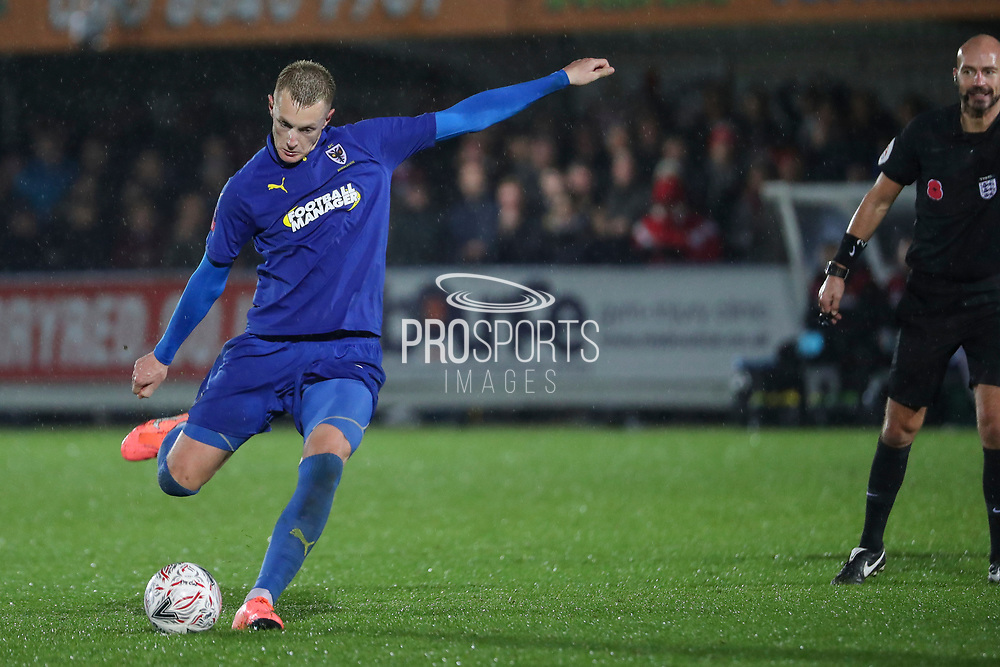 AFC Wimbledon striker Joe Pigott (39) about to hit a free kick with the ref watching during the The FA Cup match between AFC Wimbledon and Doncaster Rovers at the Cherry Red Records Stadium, Kingston, England on 9 November 2019.