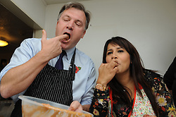 © Licensed to London News Pictures. 27/10/2014<br /> Naushabah Khan and Ed Balls tasting their Carrot Cake mix .<br /> Ed Balls, Labour's shadow chancellor,has been in Rochester on the campaign trail  today(27.10.2014)<br /> Mr Balls was joined by Labour candidate Naushabah Khan at Bruno's French Bakes shop in Rochester high Street to meet local people and make Carrot cake with Bruno Breillet  (Pastry Chief) and Naushabah Khan .<br /> Hilary Benn MP, Labour's Shadow Communities and Local Government Secretary was also at the event.<br /> <br /> (Byline:Grant Falvey/LNP)
