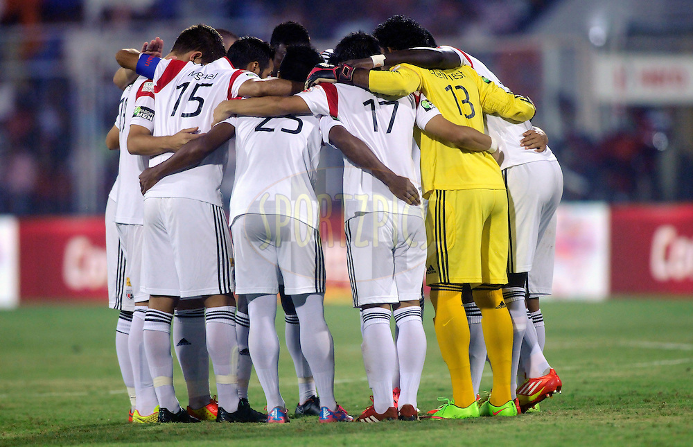 TEam NorthEast United FC form a huddle before the start of the match 46 of the Hero Indian Super League between FC Goa and North East United FC held at the Jawaharlal Nehru Stadium, Fatorda, India on the 1st December 2014.<br /> <br /> Photo by:  Pal Pillai/ ISL/ SPORTZPICS