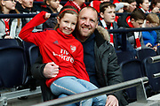 Father and daughter Arsenal fans before the FA Women's Super League match between Tottenham Hotspur Women and Arsenal Women FC at Tottenham Hotspur Stadium, London, United Kingdom on 17 November 2019.