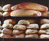 Loaves of fresh baked Italian bread stacked for sale from a street vendor in Old Naples, Italy.