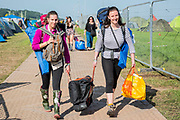 Arrivals weighed down with get head off to set up camp - The 2019 Glastonbury Festival, Worthy Farm. Glastonbury, 27 June 2019