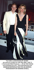 The EARL & COUNTESS OF DERBY  at a party in London on 13th May 2004.PUE 71