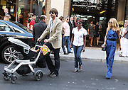01.OCTOBER.2011. PARIS<br /> <br /> RACHEL ZOE AND RODGER BERMAN TAKE THEIR BABY SON SKYLER FOR A STROLL DURING PARISIAN FASHION WEEK<br /> <br /> BYLINE: EDBIMAGEARCHIVE.COM<br /> <br /> *THIS IMAGE IS STRICTLY FOR UK NEWSPAPERS AND MAGAZINES ONLY*<br /> *FOR WORLD WIDE SALES AND WEB USE PLEASE CONTACT EDBIMAGEARCHIVE - 0208 954 5968*