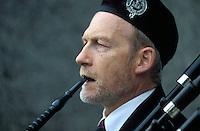 A blind bagpiper plays on Princes Street in Edinburgh, Scotland.