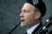 A blind bagpiper plays on Princes Street in Edinburgh, Scotland.