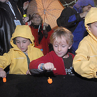 Children spin Dreidels while attempting to  break the world record at the Third Street Promenade during the annual Winterlit Celebration and Tree Lighting ceremony on Sunday, December 5, 2010.
