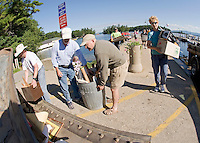 Islanders bring their unwanted items to Glendale docks on Saturday for Island cleanup day with dumpsters provided by Gilford Public Works...