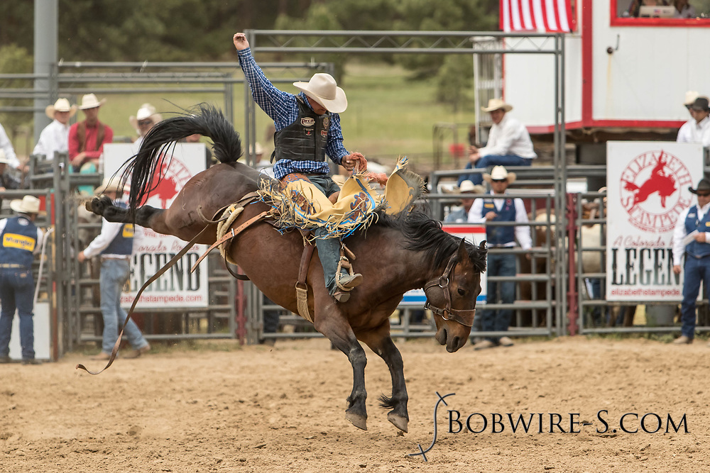 Saddle brond rider Eric Gewecke rides Summit Pro Rodeo's Scarface during the third performance of the Elizabeth Stampede on Sunday, June 3, 2018.