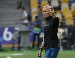 May 25, 2018 - Kiev, Ukraine - Real Madrid's head coach Zinedine Zidane attends a training session at the Olimpiyskiy Stadium in Kiev, Ukraine, 25 May 2018.The 2018 UEFA Champions League Cup final football match between Real Madrid and Liverpool FC will held on May 26 at the Olimpiyskiy Stadium. (Credit Image: © Str/NurPhoto via ZUMA Press)