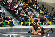 Yianni Diakomihalis of Hilton, left, competes with Mike Venosa of Victor in the championship match for the 120-pound weight class at the state qualifying wrestling meet at the College and Brockport on Saturday, February 14, 2015.