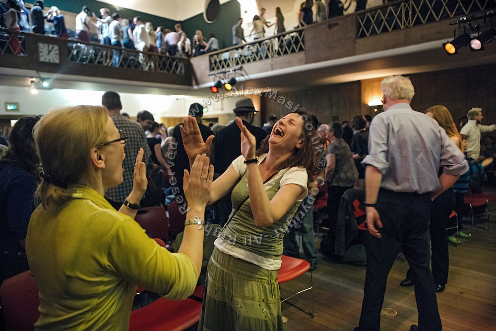 Attendees are singing dancing and cheering during The Sunday Assembly (today held inside Conway Hall in central London), an atheist service founded by British comedians Sanderson Jones and Pippa Evans in 2013, in London, England. The gathering is designed to bring together non-religious people who want a similar communal experience to a religious church. Satellite assemblies have been established in over 30 cities including New York, San Diego, and Dublin.