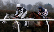 Race Winner Joshua Moore (Blue Cap) riding Torero chases Marc Goldstein on Warrant Officer  during the BlueRibandBet 1/4 Odds Each Way Every Race Handicap Hurdle at Plumpton Racecourse - 13 Dec 2015