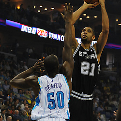 Jan 18, 2010; New Orleans, LA, USA; San Antonio Spurs center Tim Duncan (21) shoots over New Orleans Hornets center Emeka Okafor (50) during the first half at the New Orleans Arena. Mandatory Credit: Derick E. Hingle-US PRESSWIRE