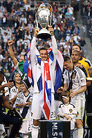 01 December 2012: Los Angeles' David Beckham (ENG), with Robbie Keane (IRL) (right), holds the Philip F. Anschutz Trophy overhead. The Los Angeles Galaxy played the Houston Dynamo at the Home Depot Center in Carson, California in MLS Cup 2012. Los Angeles won the game 3-1.