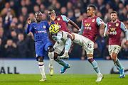 Chelsea midfielder Ngolo Kanté (7) clashes with Aston Villa midfielder Marvelous Nakamba (11) and Aston Villa defender Ezri Konsa (15) during the Premier League match between Chelsea and Aston Villa at Stamford Bridge, London, England on 4 December 2019.