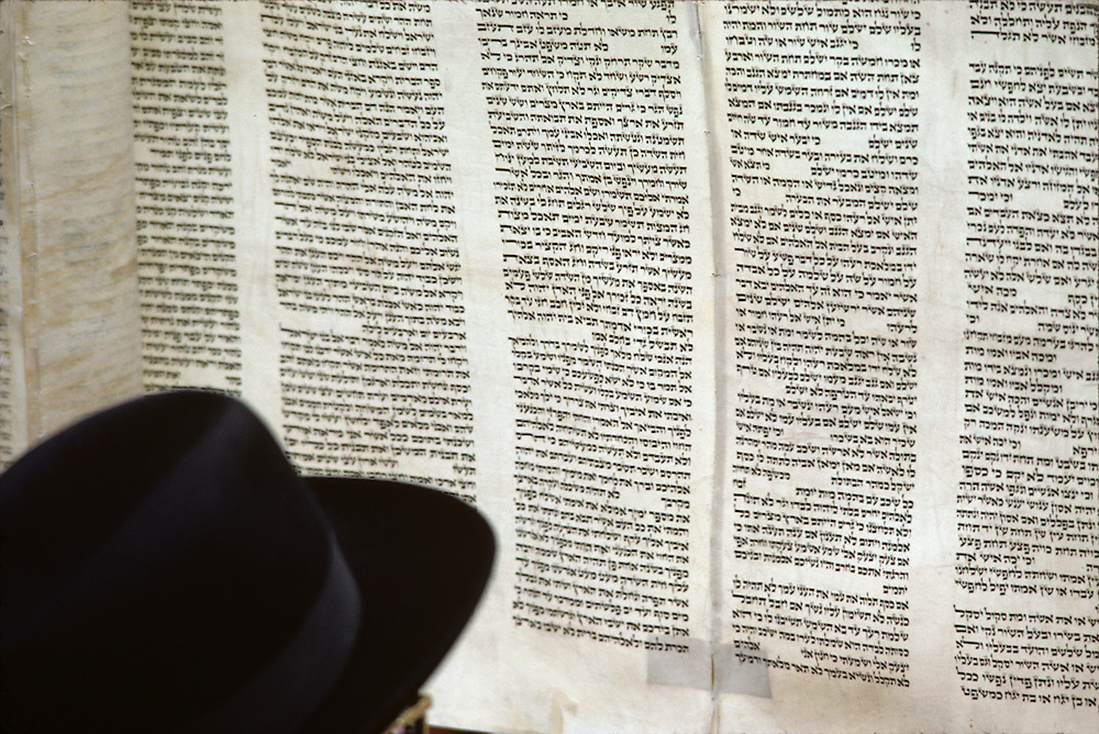 Israel, Jerusalem, Detail of Jewish man reading from Torah at Western Wall during celebration of Passover