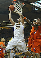 November 29, 2011: Iowa Hawkeyes forward Andrew Brommer (20) puts up a shot as Clemson Tigers guard T.J. Sapp (1) defends during the first half of the NCAA basketball game between the Clemson Tigers and the Iowa Hawkeyes at Carver-Hawkeye Arena in Iowa City, Iowa on Tuesday, November 29, 2011. Clemson defeated Iowa 71-55 in the Big Ten-ACC Challenge game.