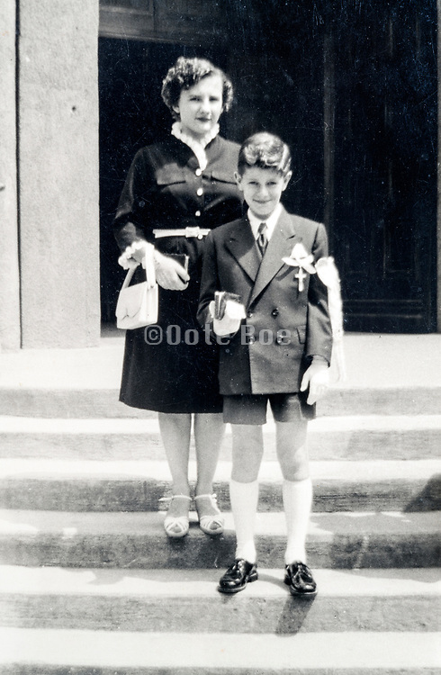mother with son during his holy communion day