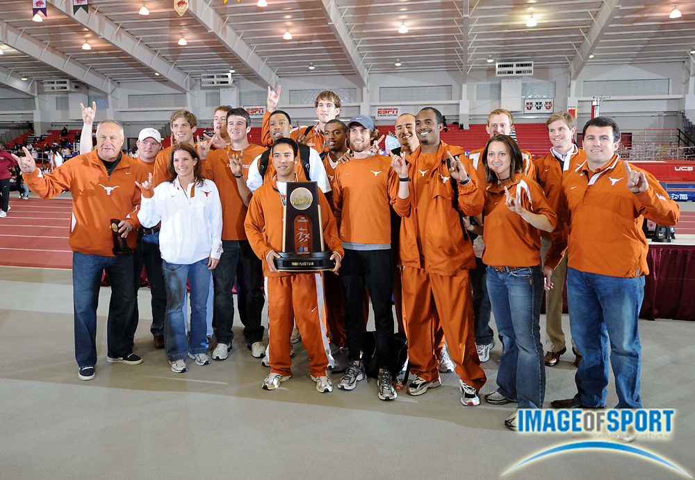 Mar 15, 2008; Fayetteville, AR, USA; The Texas men and coach Bubba Thornton pose with championship plaque after finishing third in the NCAA indoor track and field championships at the Randal Tyson Center.
