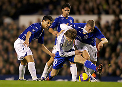 Liverpool, England - Wednesday, December 5, 2007: Everton's Tim Cahill and Phil Jagielka tackle Zenit St. Petersburg's Andrey Arshavin during the UEFA Cup Group A match at Goodison Park. (Photo by David Rawcliffe/Propaganda)