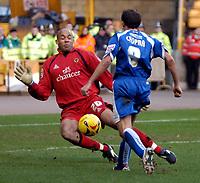 Photo: Ed Godden/Sportsbeat Images.<br />Wolverhampton Wanderers v Cardiff City. Coca Cola Championship. 20/01/2007. Cardiff's Michael Chopra is met by Wolves keeper Matt Murray.