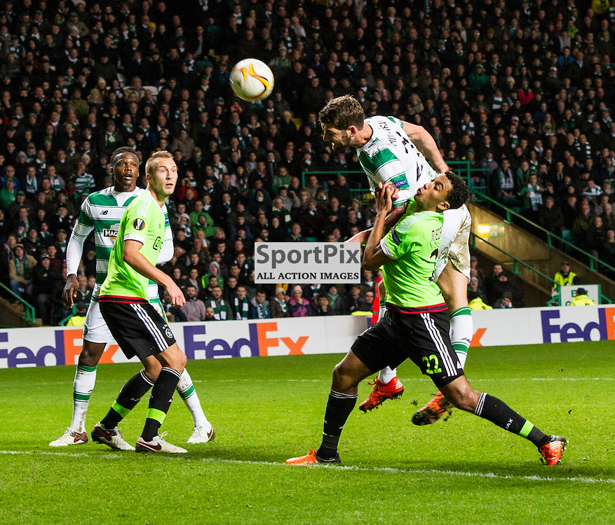 Charlie Mulgrew uses his strength to get to the ball while under pressue from Jairo Riedewald as Celtic host Ajax at Parkhead in the Europa League.<br /> &copy; Ger Harley/ SportPix.org.uk 26 November 2015