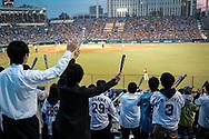Fans of The Tokyo swallows support their team at the Jingu Baseball Stadium in Tokyo during a game Tokyo Swallows VS Hiroshima Carp, Japan. 21/04/2017-Tokyo, JAPAN