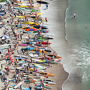 Competitors in the open-age group race at the fifth annual Rainbow Sandals and Gerry Lopez Battle of the Paddle at Doheny State Beach in Dana Point, CA on September 30, 2012. The race set a Guinness Book of World Records as the world's largest stand-up paddleboard race, as 389 competitors finished the race.