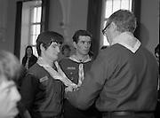 Scout Inducted Using Sign Language.   (P6)..1981..08.12.1981..12.08.1981..8th December 1981..Joe Needham, a deaf and dumb resident in Stewart's Hospital, Palmerstown, Co Dublin was enrolled into the 43rd Dublin (Palmerstown) unit of the Scouting Association of Ireland. The Chief Scout, Mr Joe McGough carried out the enrollment at the hospital. Ms Domenica Malocca, a teacher in the class for the deaf at the hospital, translated the Scout Promise into sign language during the ceremony...Mr Joe McGough, is pictured, presenting Joe Needham with his neckerchief and woggle as he is oficially inducted into the scout movement.