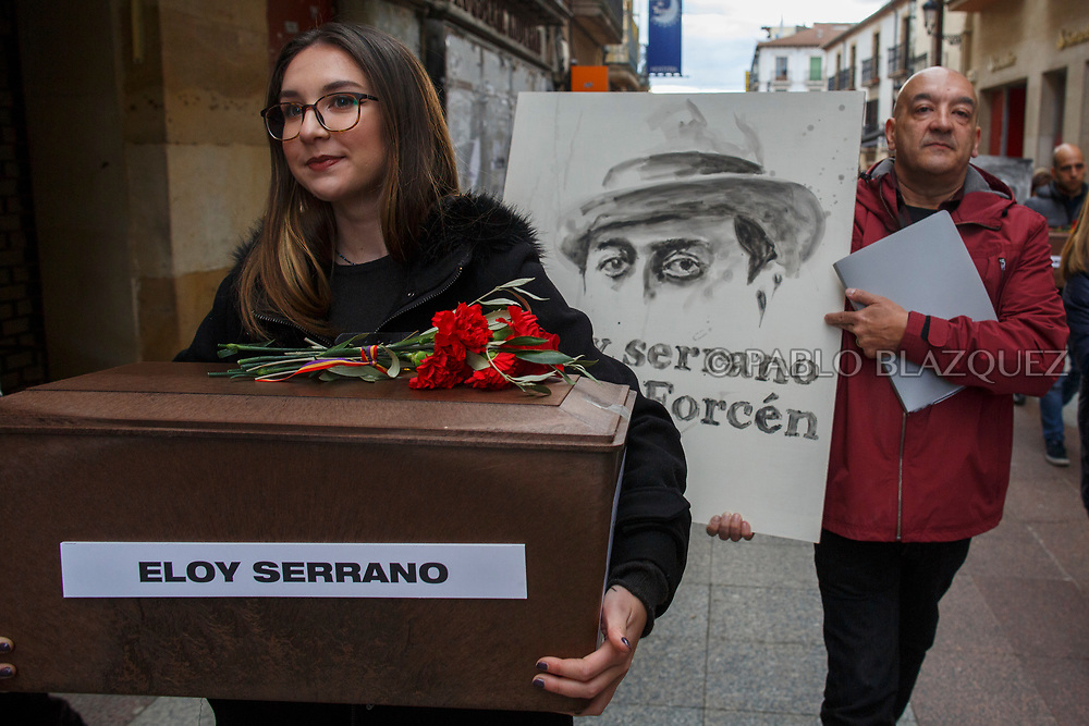 14/04/2018. A relative carry a coffin containing the remains of victim of Spain Civil War Eloy Serrano Forcen as his grandson Victor Illa carries a portrait depicting him along the streets in center of Soria during a homage to hand the remains to their families on April 14, 2018 in Soria, Spain. La Asociacion Soriana Recuerdo y Dignidad (ASRD) 'The Soria Association for Memory and Dignity' celebrated a tribute to hand over the remains of civil war victims to their families. The Society of Sciences of ARANZADI helped with the research, exhumation and identification of the bodies, after villagers passed the information about the mass grave, 81 years after the assassination took place, to the ASRD. Seven people were assassinated around August 25, 1936 by Falangists, as part of General Francisco Franco armed forces, and buried in the 'Fosa de los Maestros' (Teachers Mass Grave) near Cobertelada, Soria, after being taken from prison of Almazan during the Spanish Civil War. Five of them were teachers in the region, and also friends of Spanish writer Antonio Machado. The other two still remain unidentified. Another body was assassinated by Falangists accompanied by a priest in 1936, and was exhumed on 23 September of 2017 near Calata&ntilde;azor, Soria. It belonged to Abundio Andaluz, a politician, lawyer and musician in Soria.<br /> Spain's Civil War took the lives of thousands of people on both sides, and civilians. But Franco continued his executions after the war has finished. Teachers, as part of the education sector, were often a target of Franco's forces. Spanish governments has never done anything to help the victims of the Civil War and Franco's dictatorship while there are still thousands of people missing in mass graves around the country. (&copy; Pablo Blazquez)