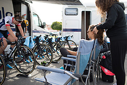 A team helper braids the hair of Ashleigh Moolmann-Pasio (RSA) of Cervélo-Bigla Cycling Team before the start of the 42,5 km team time trial of the UCI Women's World Tour's 2016 Crescent Vårgårda women's road cycling race on August 19, 2016 in Vårgårda, Sweden. (Photo by Balint Hamvas/Velofocus)