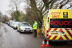 © Licensed to London News Pictures. 31/12/2013, Bosham, UK.  Police at the scene where a murder enquiry has been launched after a 55-year-old woman was found dead with serious head injuries at a house at Smuggler's Lane, in Bosham, near Chichester, West Sussex, on Monday morning. Photo Credit: Rob Arnold/LNP