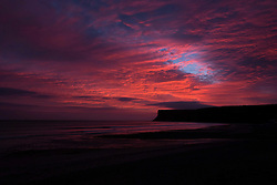 © Licensed to London News Pictures. 08/03/2014<br /> <br /> Saltburn, England<br /> <br /> Dramatic skies are seen over Huntcliff in Saltburn, Cleveland at sunrise.<br /> <br /> Photo credit : Ian Forsyth/LNP