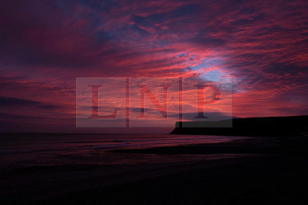 © Licensed to London News Pictures. 08/03/2014<br /> <br /> Saltburn, England<br /> <br /> Dramatic skies are seen over Huntcliff in Saltburn, Cleveland at sunrise.<br /> <br /> Photo credit : Ian Forsyth/LNP