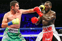 Los Angeles, CA - July 11, 2015: Mauricio Herrera (green trunks) and Hank Lundy (silver trunks) during their HBO Latino main event at the Los Angeles Sports Arena in Los Angeles, CA.  Ed Mulholland for HBO Latino.