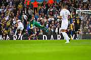 Leeds United forward Patrick Bamford (9) gets in front of Brentford goalkeeper David Raya (1) and takes a shot during the EFL Sky Bet Championship match between Leeds United and Brentford at Elland Road, Leeds, England on 21 August 2019.