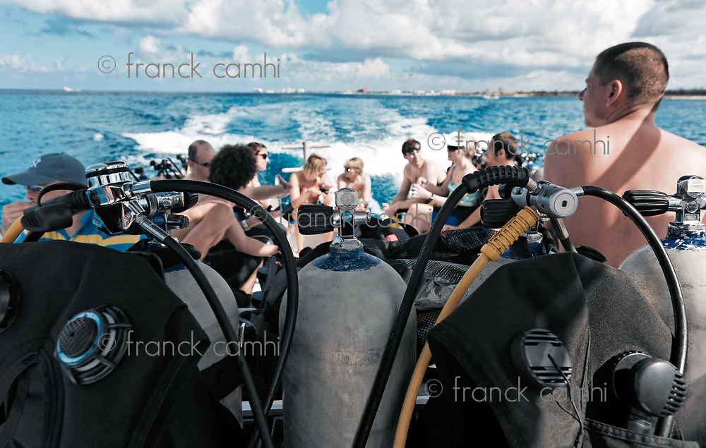 scuba diving equipment on a boat on a sea