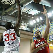 Maine Red Claws Forward Vitor Faverani (34) take short range shot as Delaware 87ers Center Hamady N'Diaye (33) defends in the first half of an NBA D-league regular season basketball game between the Delaware 87ers (76ers) and the Maine Red Claws (Boston Celtics) Tuesday, Feb. 4, 2014 at The Bob Carpenter Sports Convocation Center, Newark, DE