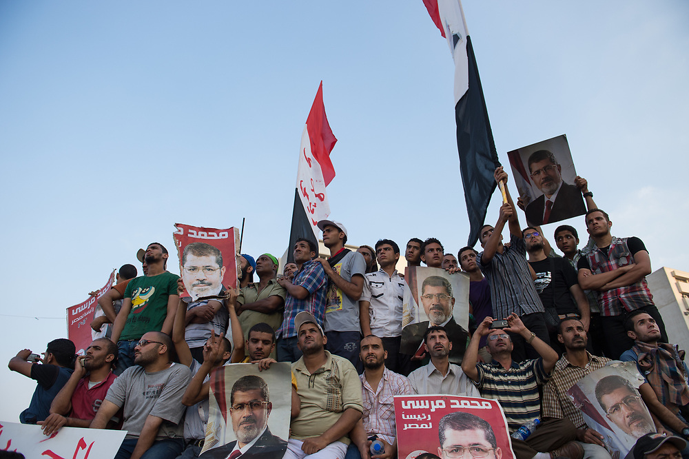 Supporters of ousted President Morsi demand his reinstatement during a rally in front of the Republican Guard Headquarters in Heliopolis, Cairo, Egypt, July 5, 2013