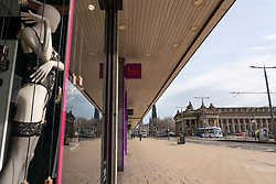 Edinburgh, Scotland, UK. 24 March, 2020.  Princes Street which is Edinburgh's main shopping street is very quiet. All shops and restaurants are closed with very few people venturing outside following the Government imposed lockdown today. Pictured; a mannequin in Ann Summers window looks out onto a deserted Princes Street. Iain Masterton/Alamy Live News