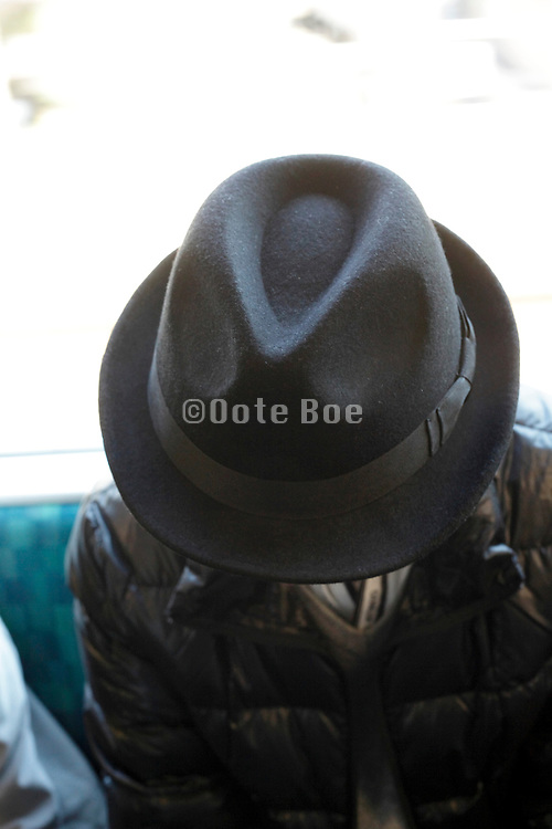 male person wearing a classic style hat