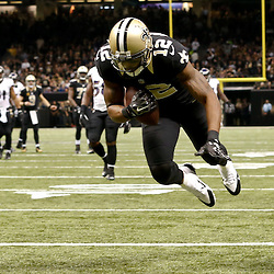 Nov 24, 2014; New Orleans, LA, USA; New Orleans Saints wide receiver Marques Colston (12) catches a 26 yard touchdown against the Baltimore Ravens during the second quarter of a game at the Mercedes-Benz Superdome. Mandatory Credit: Derick E. Hingle-USA TODAY Sports