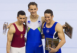 Second placed Dmitrijs Trefilovs of Latvia, winner Saso Bertoncelj of Slovenia and third placed Alexander Naddour of USA celebrate at trophy ceremony after competing  in Pommel Horse during Final day 1 of Artistic Gymnastics World Cup Ljubljana, on April 27, 2013, in Hala Tivoli, Ljubljana, Slovenia. (Photo By Vid Ponikvar / Sportida.com)