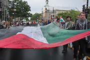 Throughout the march, several protesters supporting a huge Palestinian flag on which supporters have signed their names and wrote words of support to the people of Gaza.