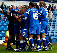 Fotball<br /> Foto: SBI/Digitalsport<br /> NORWAY ONLY<br /> <br /> Leeds United v Millwall<br /> Coca Cola Championship.<br /> 07/08/2005.<br /> <br /> Millwall's Don Hutchison has to be restrained by the referee's assistant as Millwall players run towards the Leeds fans to celebrate in the absence of any of their own supporters, amidst repeated taunts of team mate Jodie Morris