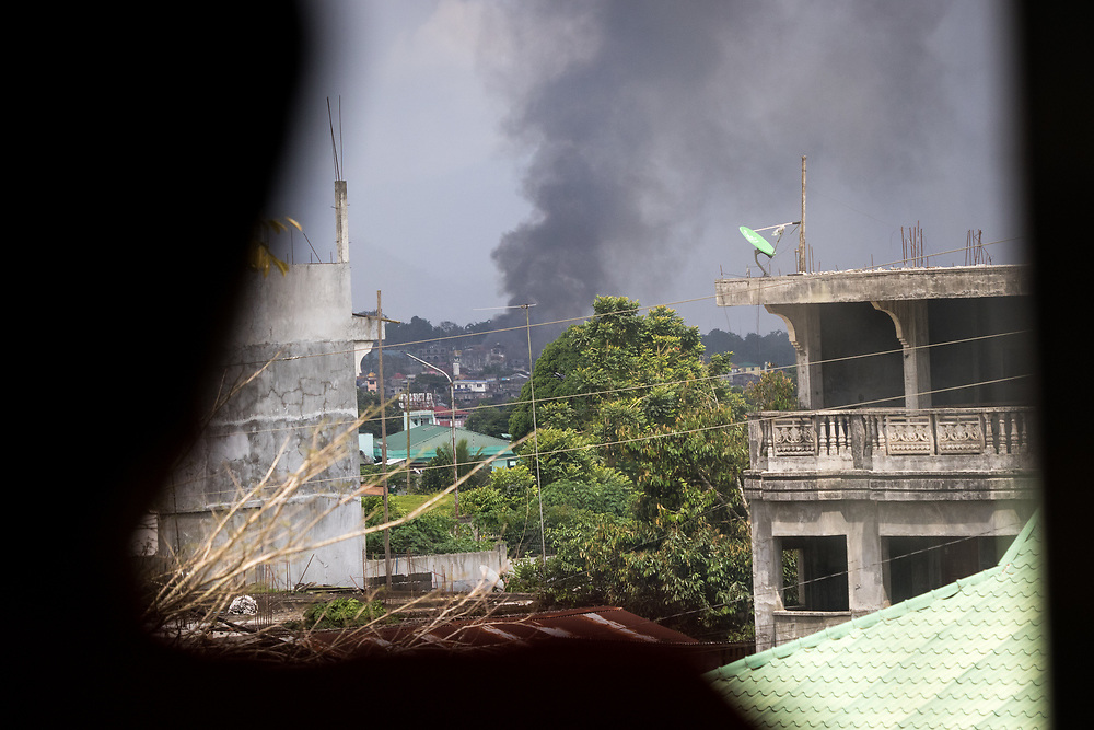 MARAWI, PHILIPPINES - JUNE 4: A smoke is seen inside of Marawi city during a fight between Islamist rebels and Philippine troops in southern Philippines June 4, 2017. (Photo: Richard Atrero de Guzman/ANADOLU Agency)