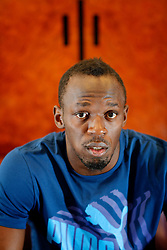 UK ENGLAND LONDON 28JUL13 - Jamaican sprinter Usain Bolt reacts during an interview at the Tower Hotel in London, England.<br /> <br /> He is the first man to hold both the 100 metres and 200 metres world records, and along with his teammates, he also set the world record in the 4×100 metres relay. He is the reigning Olympic champion in these three events, the first man to win six Olympic gold medals in sprinting, and a five-time World champion.<br /> <br /> jre/Photo by Jiri Rezac<br /> <br /> © Jiri Rezac 2013